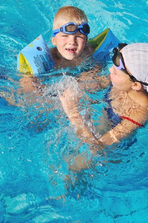 happy kids have fun on outdoor swimming pool at beautiful aquapark Stock Photo - 6049482