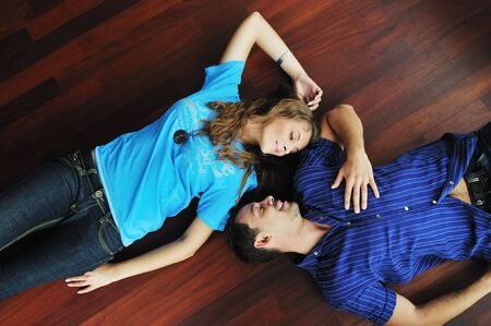 happy young cuple have fun and relax in their new big bright home apartment  photo
