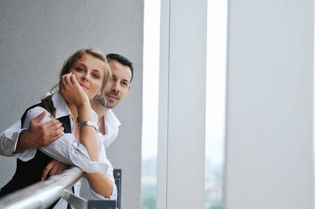 romantic happy couple relax and have fun at balcony in their new home apartment Stock Photo - 5552859