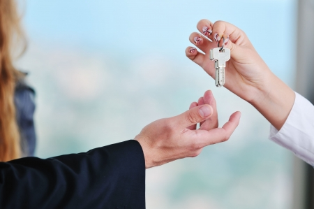 man and woman hand closeup with home keys representing buying and selling new apartment and real estate concept Stock Photo - 5552863
