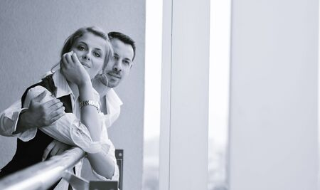 romantic happy couple relax and have fun at balcony in their new home apartment photo