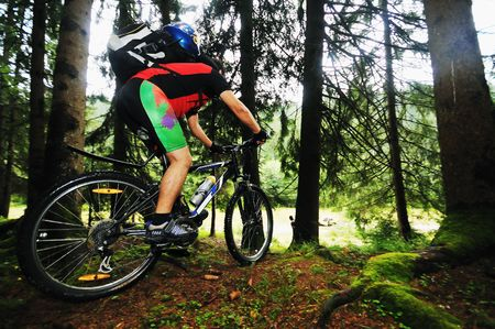 healthy lifestyle and fitness concept with mount bike man outdoor photo