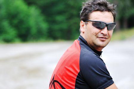 mountain bike with sport sunglasses portrait outdoor photo