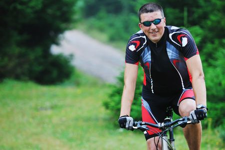 healthy lifestyle and fitness concept with mount bike man outdoor Stock Photo