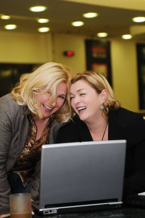 two happy mature senior business  woman work on laptop computer photo