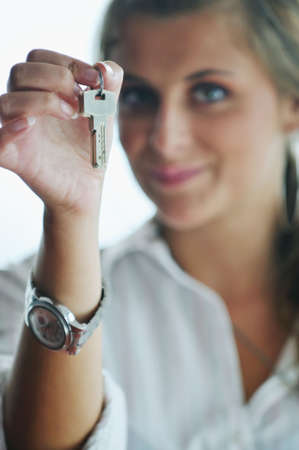 happy young woman throw keys from their apartment and home in ai and representing concept of joy and financial freedom photo