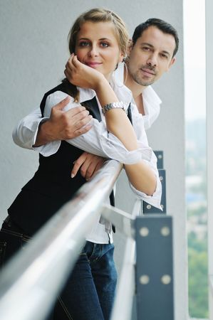 romantic happy couple relax and have fun at balcony in their new home apartment Stock Photo - 5686352