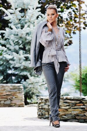 young woman outdoor with fasnionable clothing photo