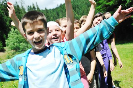 child play: happy children group  have fun outdoor in nature at suny day