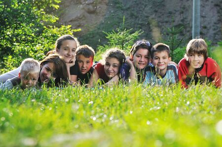 happy children group  have fun outdoor in nature at suny day photo