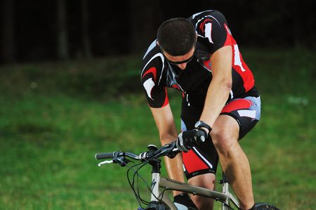 healthy lifestyle and fitness concept with mount bike man who ride bike  outdoor photo