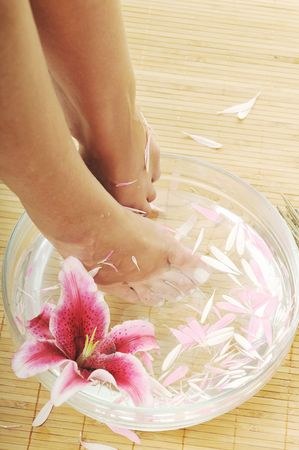 aroma bowl: woman spa pedicure foot treatment with water and flower