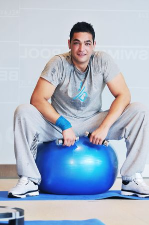 one young healthy man exercice fitness recreation and yoga indoor photo