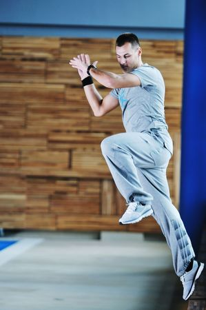 exercice: one young healthy man exercice fitness recreation and yoga indoor