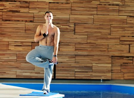 man meditating: young man exercise and practice yoga fitness  in lotus position indoor