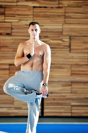 young man exercise and practice yoga fitness  in lotus position indoor Stock Photo - 5847165