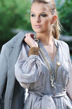 young woman posing in fashion  business and caual clothing outdoor photo