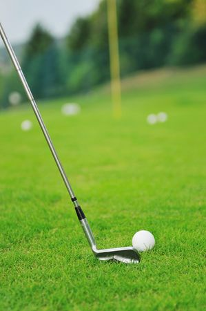 golf ball on sports golf course and hole photo