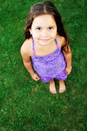 happy young girl children relax lie and have fun on grass with flower Stock Photo - 5857475