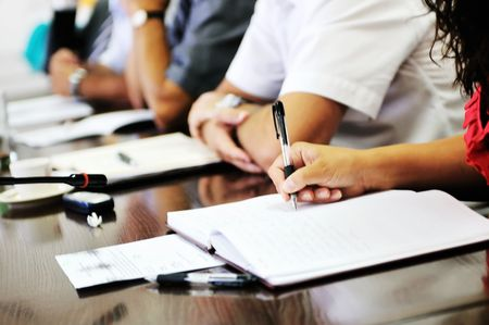 business beople on meeting conference taking notes and make deal   photo