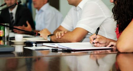 conference meeting: business beople on meeting conference taking notes and make deal