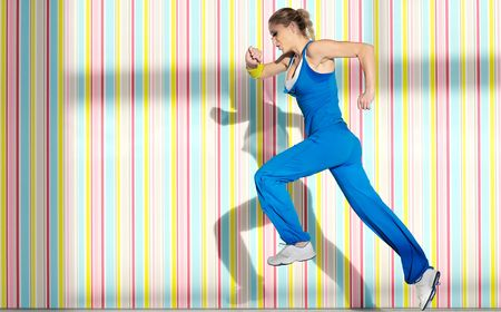 young woman running: one young healthy woman exercice fitness run and jump in air