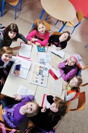 child classroom: happy childrens group in schoold have fun and learning leassos Stock Photo