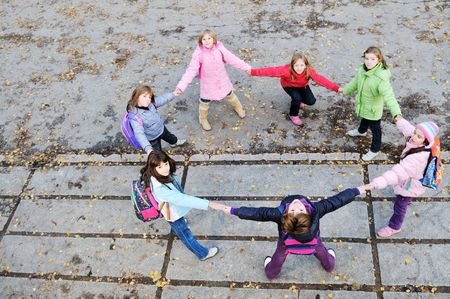 happy young child group outdoor standing together in circle formation and representing teamwork and friendship concept Stock Photo - 6118519
