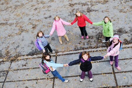 happy young child group outdoor standing together in circle formation and representing teamwork and friendship concept Stock Photo - 6118528
