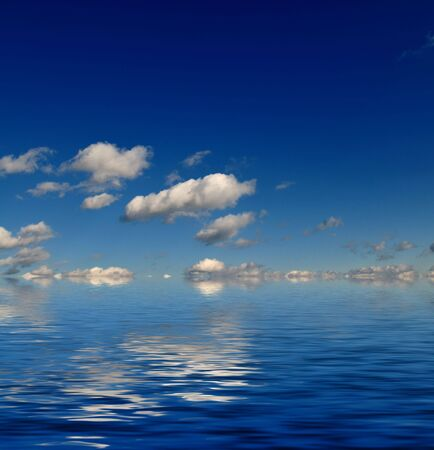 blue sky with white clouds and abstract water reflection in nature background photo
