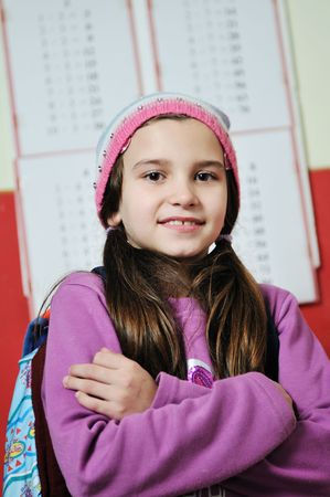 happy school girl on math classes finding solution and solving problemshappy young school girl portrait on math class Stock Photo - 6118421