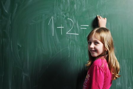 happy school girl on math classes finding solution and solving problems Stock Photo - 6118349