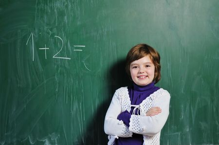 regard: happy school girl on math classes finding solution and solving problems Stock Photo