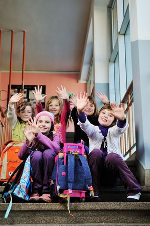 school bags: happy childrens group in schoold have fun and learning leassos Stock Photo