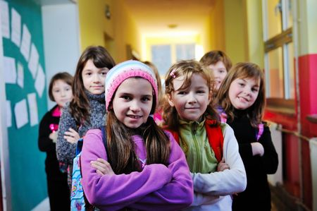 grade school: happy childrens group in schoold have fun and learning leassos Stock Photo