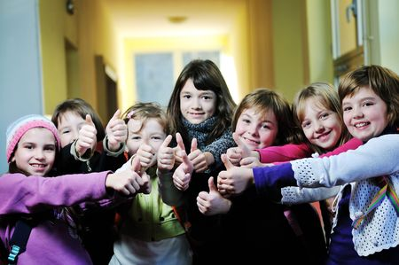classmate: happy childrens group in schoold have fun and learning leassos Stock Photo