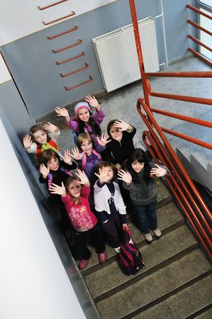 happy childrens group in schoold have fun and learning leassos photo