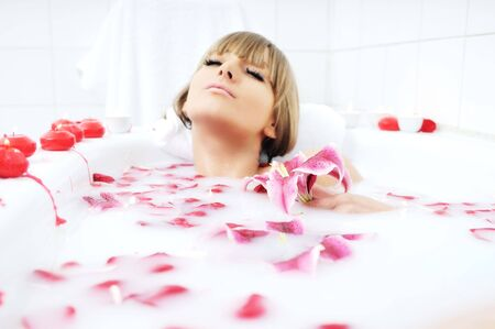 woman beauty spa and wellness treathment with red flower petals in bath with milk Stock Photo - 5978488