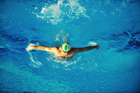 sportman: health and fitness lifestyle concept with young athlete swimmer recreating  on olimpic pool Stock Photo