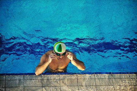 health and fitness lifestyle concept with young athlete swimmer recreating  on olimpic pool photo
