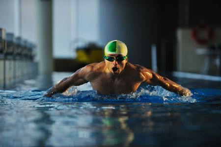 swimming race: health and fitness lifestyle concept with young athlete swimmer recreating  on olimpic pool Stock Photo