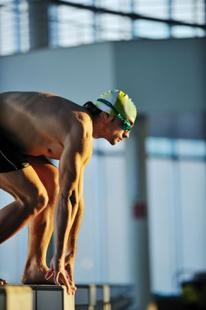 start position race concept with fit swimmer on swimming pool Stock Photo - 5979308
