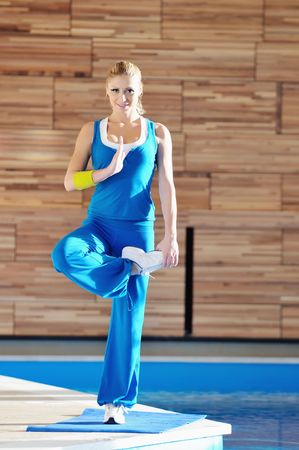 young woman exercise and practice yoga and fitness in fitness club photo