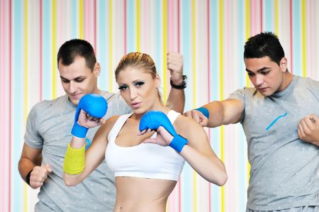 group of young adults exercise in fitness club with trainer photo