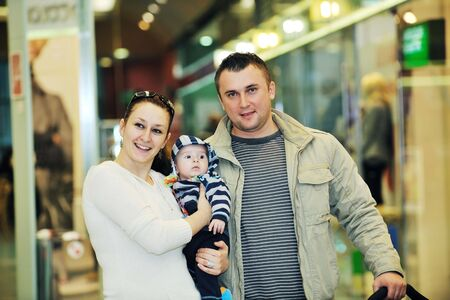 happy young family in shopping centre indoor  photo