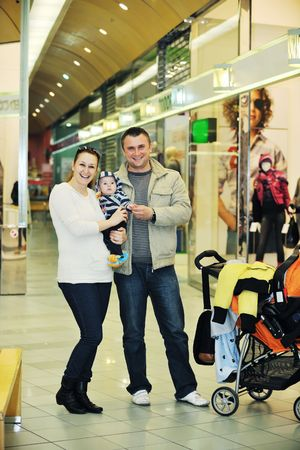 happy young family in shopping centre indoor Stock Photo - 6028611