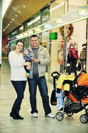 happy young family in shopping centre indoor Stock Photo - 6028660