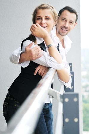 romantic happy couple relax and have fun at balcony in their new home apartment Stock Photo - 6226865