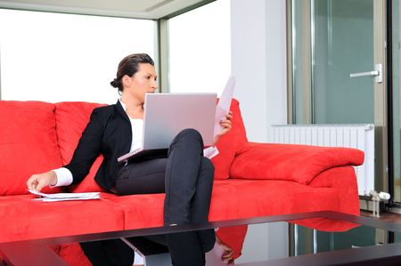 home confort: young business woman working on laptop at home in confort bright apartment Stock Photo