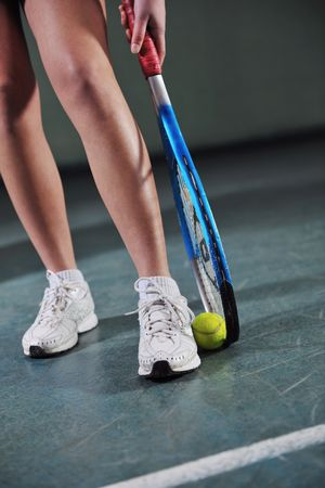 one woman playing tennis sport indoor photo